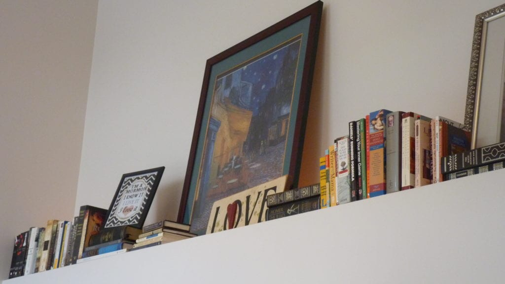 Add Books and pictures to a high ledge in a room to add texture