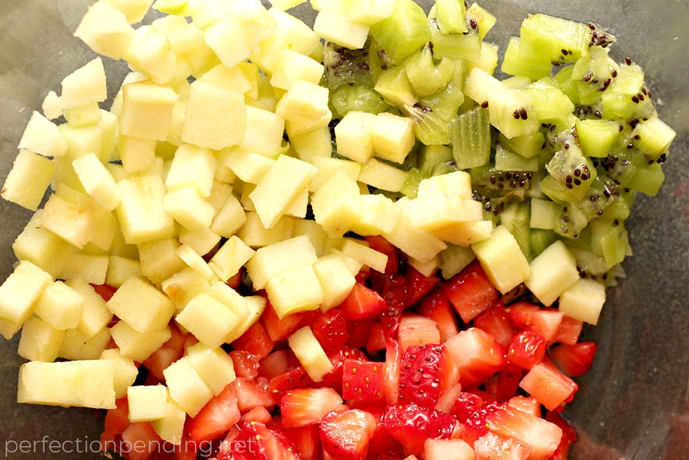 This apple berry summer salsa is the PERFECT treat for the end of summer. It's sweet, refreshing, and soooo delicious! If you're looking for an easy fruit salsa recipe - you'll want to try this. It's a healthy fruit salsa everyone will love. Perfect for last minute barbecues, summer parties, playdates, and even birthdays.