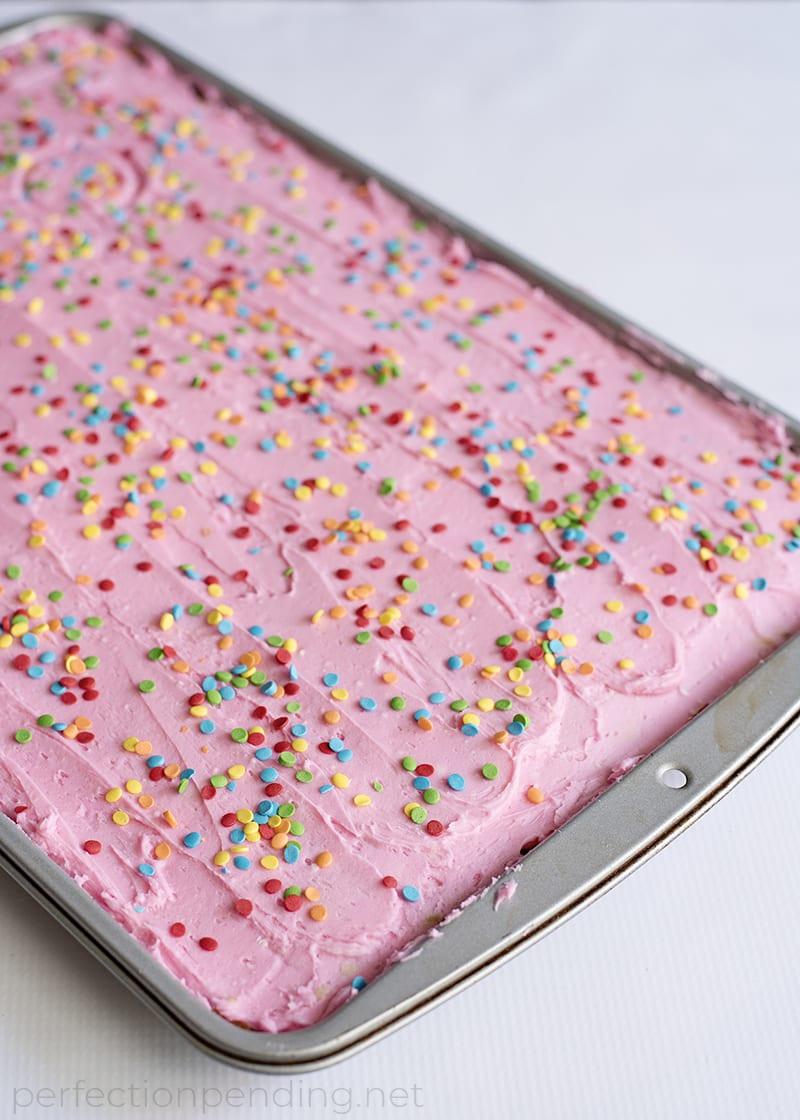 These frosted sugar cookie bars are THE BEST sugar cookie bars and an absolute must try! Between the sweet sugar cookie and the sweet fun frosting and sprinkles, these are such a delicious sweet treat! Not to mention they are some perfect soft and chewy cookie bars - my favorite type of cookie! Just scroll down below to find the full pan sugar cookie recipe!