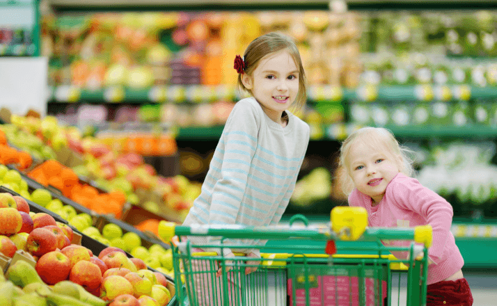 Shopping with kids can be an overwhelming task. These sanity saving tips to make going to the grocery store with your kids easier, are the BEST mom hacks you will find for shopping with little kids. #momlife #parenting #shopping #momhacks #shoppingwithkids #popcart